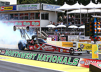 Aug. 2, 2014; Kent, WA, USA; NHRA top fuel dragster driver Spencer Massey during qualifying for the Northwest Nationals at Pacific Raceways. Mandatory Credit: Mark J. Rebilas-