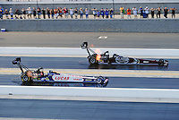 Sept. 18, 2010; Concord, NC, USA; NHRA top fuel dragster driver Shawn Langdon (left) races alongside Larry Dixon during qualifying for the O'Reilly Auto Parts NHRA Nationals at zMax Dragway. Mandatory Credit: Mark J. Rebilas /