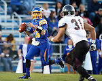 BROOKINGS, SD - OCTOBER 11:  Zach Lujan #16 from South Dakota State looks for a receiver as Dylan Cole #31 Missouri State defends in the first half of their game Saturday evening at Coughlin Alumni Stadium in Brookings. (Photo/Dave Eggen/Inertia)