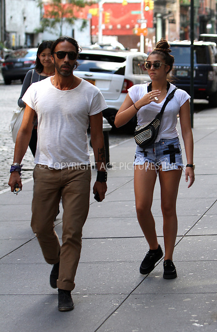 WWW.ACEPIXS.COM....September 9 2012, New York City....Madonna's daughter Lourdes Leon walks with her father Carlos Leon in Soho on September 9 2012 in New York City......By Line: Zelig Shaul/ACE Pictures......ACE Pictures, Inc...tel: 646 769 0430..Email: info@acepixs.com..www.acepixs.com