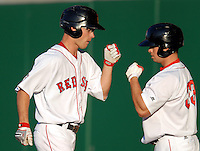 OFJosh Reddick of the Pawtucket Red Sox is greeted by fellow OF Daniel Nava following a HR vs.the Indianapolis Indians at McCoy Stadium in Pawtucket, RI on April 30, 2010 (Photo by Ken Babbitt/Four Seam Images)