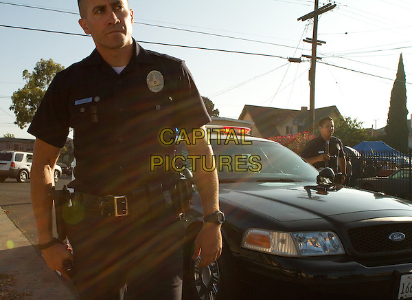 JAKE GYLLENHAAL, MICHAEL PENA.in End of Watch (2012).*Filmstill - Editorial Use Only*.CAP/FB.Supplied by Capital Pictures.