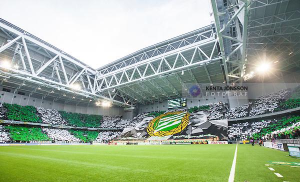 Stockholm 2014-04-14 Fotboll Superettan Hammarby IF - Degerfors IF :  <br /> Hammarby supportrar med ett tifo innan matchen i gr&ouml;nt och vitt p&aring; l&auml;ktarna i Tele2 Arena och med en stor banderoll f&ouml;rest&auml;llande f&ouml;reningens grundare <br /> (Foto: Kenta J&ouml;nsson) Nyckelord:  HIF Bajen Degerfors  supporter fans publik supporters