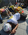 June 7, 2012, Tokyo, Japan - Protesters stage a die-in demonstration against the proposed restart of Oi Nuclear Power Plant in front of Japanese prime ministers official residence in Tokyo on Thursday, June 7, 2012...The government is set to decide to reactivate the plants two reactors in Fukui Prefecture, some 496km west of Tokyo, but 71 percent of the recent poll taken by a Japanese newspaper opposed the hasty restart of the idled reactors. About a hundred women, many of whom from Fukushima where they have had a nuclear crisis of their own since last March 11, staged a peaceful protest against the planned reactivation of the Fukui reactors. (Photo by Natsuki Sakai/AFLO) AYF -mis-.