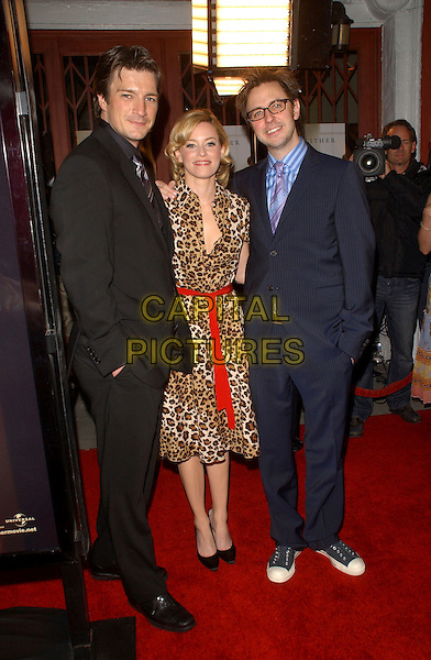 "NATHAN FILLION, ELIZABETH BANKS & JAMES GUNN.World Premiere of ""Slither"" held at The Vista Theatre in Los Feliz, California, USA. .March 9th, 2006.Ref: DVS.full length leopard print dress black suit blue.www.capitalpictures.com.sales@capitalpictures.com.Supplied By Capital PIctures"