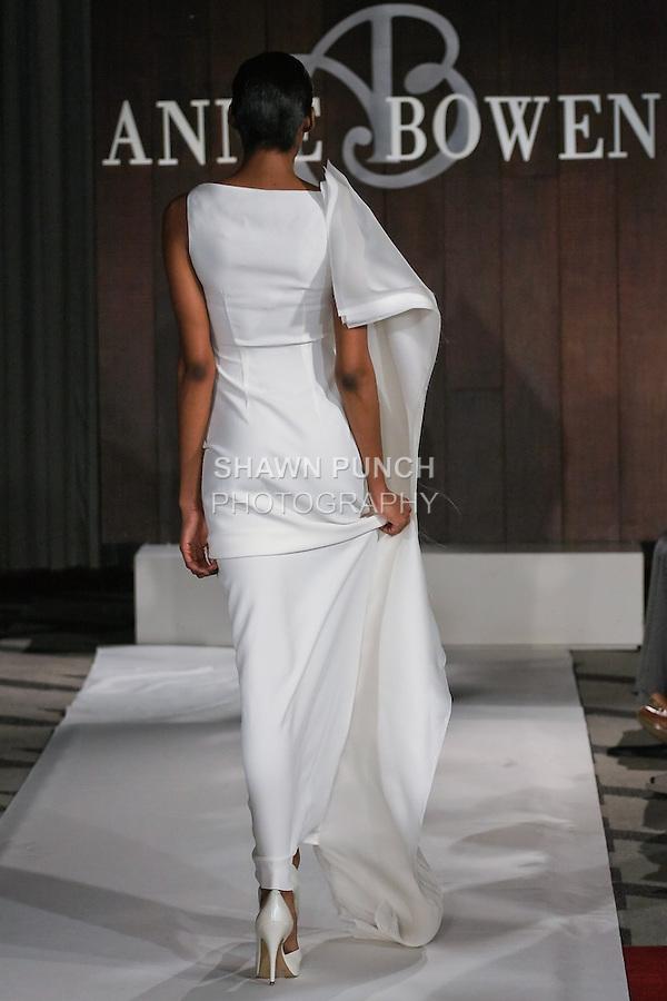 Model walks runway in a Wild Flowers wedding dress by Anne Bowen, for the Anne Bowen Bridal Spring 2012 runway show.