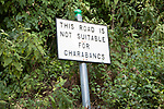 Unusual old road sign saying This Road is Not Suitable for Charabancs at Wookey Hole, Somerset, England, UK