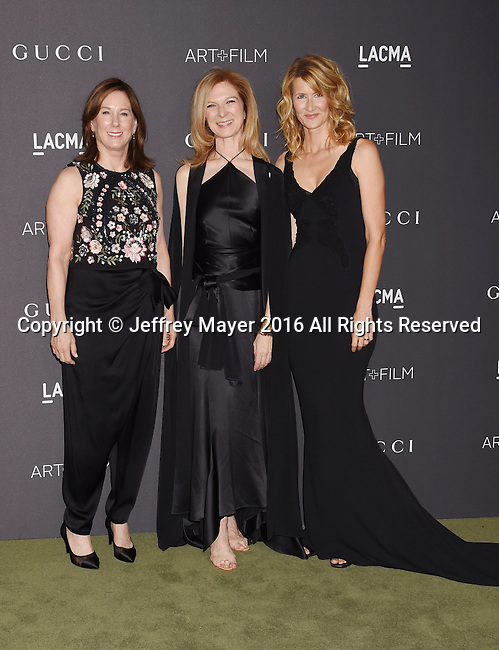 LOS ANGELES, CA - OCTOBER 29: (L-R) Producer Kathleen Kennedy, CEO of the Academy of Motion Picture Arts and Sciences Dawn Hudson, and actress Laura Dern attend the 2016 LACMA Art + Film Gala honoring Robert Irwin and Kathryn Bigelow presented by Gucci at LACMA on October 29, 2016 in Los Angeles, California.