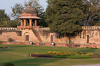 "Agra, India.  Interior Gardens of the  Itimad-ud-Dawlah, Mausoleum of Mirza Ghiyas Beg.  Chhatri on corner of garden wall.  The Itimad-ud-Dawlah is sometimes referred to as the ""Baby Taj."""