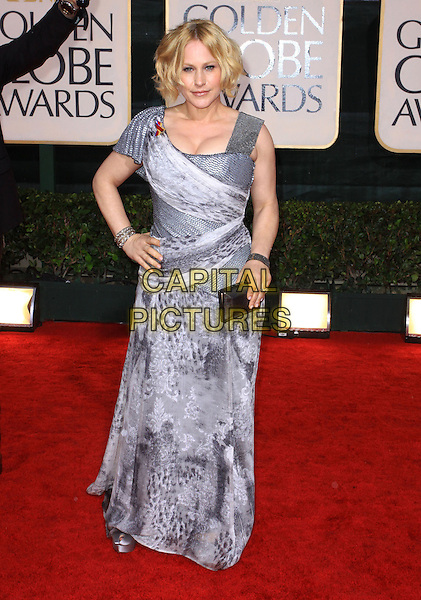 PATRICIA ARQUETTE.67th Golden Globe Awards held Beverly Hilton, Beverly Hills, California, USA..January 17th, 2010.globes full length hand on hip grey gray dress long maxi silver print clutch bag .CAP/ADM/KB.©Kevan Brooks/Admedia/Capital Pictures