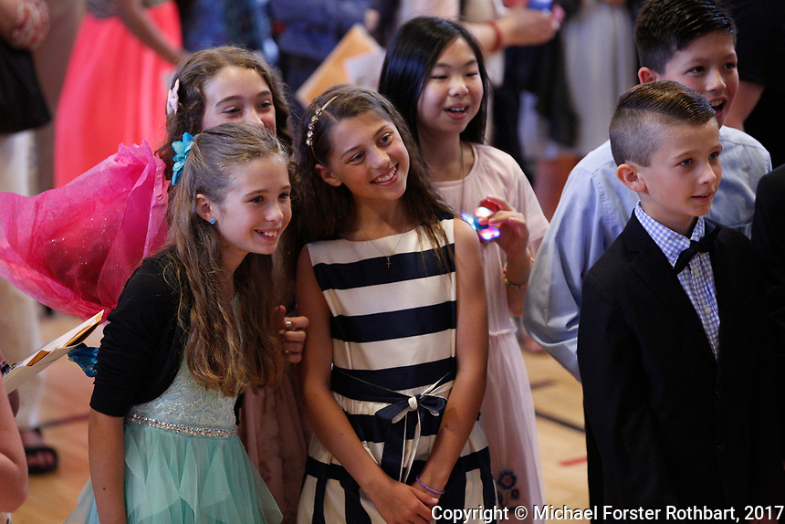 The Oneonta Greater Plains elementary school fifth grade awards ceremony, on June 21, 2017.<br /> &copy; Michael Forster Rothbart Photography<br /> www.mfrphoto.org &bull; 607-267-4893<br /> 34 Spruce St, Oneonta, NY 13820<br /> 86 Three Mile Pond Rd, Vassalboro, ME 04989<br /> info@mfrphoto.org<br /> Photo by: Michael Forster Rothbart<br /> Date:  6/21/2017<br /> File#:  Canon &mdash; Canon EOS 5D Mark III digital camera frame C19456
