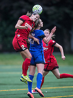 Seattle, Washington - Saturday May 14, 2016:  Portland Thorns FC defender Katherine Reynolds (2) goes up for a header over Seattle Reign FC midfielder Beverly Yanez (17) during the first half of a match at Memorial Stadium on Saturday May 14, 2016 in Seattle, Washington. The match ended in a 1-1 draw.