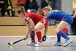 GER - Mannheim, Germany, December 19: During the 1. Bundesliga Sued Damen indoor hockey match between Mannheimer HC (blue) and Nuernberger HTC (red) on December 19, 2015 at Irma-Roechling-Halle in Mannheim, Germany. (Photo by Dirk Markgraf / www.265-images.com) *** Local caption *** Nina Meller #22 of Nuernberger HTC, Antonia Hering #34 of Mannheimer HC