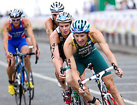 25 JUL 2010 - LONDON, GBR - Jonathan Brownlee (#47) keeps on the back wheel of Stuart Hayes on the bike at the mens race of the London round of the ITU World Championship Series triathlon .(PHOTO (C) NIGEL FARROW)