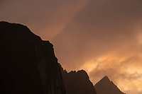 Colorful autumn sunset behind mountain peaks, Moskenesøy, Lofoten Islands, Norway