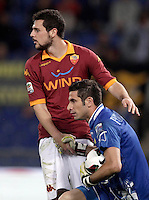 Calcio, Serie A: Roma vs Chievo Verona, Stadio Olimpico, , 7 maggio  2013..ChievoVerona goalkeeper Christian Puggioni is helped by AS Roma forward Mattia Destro, left, during the Italian serie A football match between Roma and ChievoVerona at Rome's Olympic stadium, 7 maggio  2013..UPDATE IMAGES PRESS/Isabella Bonotto