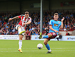 Billy Sharp of Sheffield Utd and Richard Smallwood of Scunthorpe Utd during the English League One match at Glanford Park Stadium, Scunthorpe. Picture date: September 24th, 2016. Pic Simon Bellis/Sportimage