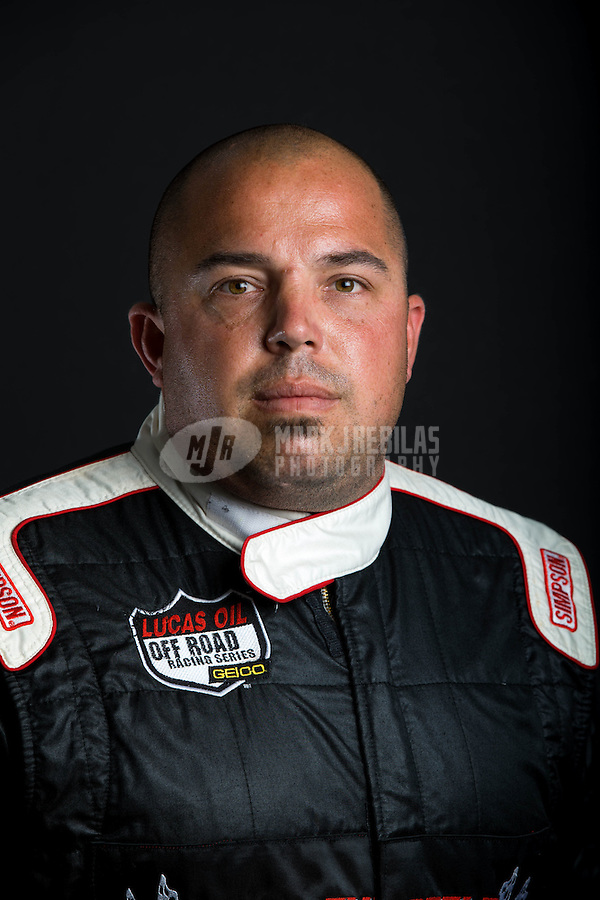 Mar. 21, 2014; Chandler, AZ, USA; LOORRS pro buggy driver Mike Valentine poses for a portrait prior to round one at Wild Horse Motorsports Park. Mandatory Credit: Mark J. Rebilas-USA TODAY Sports