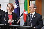 AUSTRALIA, Canberra : U Thein Sein President of Myanmar (R) listens during a press conference with Australian Prime Minister Julia Gillard (L) at Parliament House, Canberra on March 18, 2013. AFP PHOTO / Mark GRAHAM