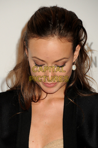"OLIVIA WILDE .at LACMA's ""The Unmasking"" The Lynda & Stewart Resnick Exhibition Pavilion Opening Gala at The Los Angeles County Museum of Art in Los Angeles, California, USA, September 25th 2010..portrait headshot earrings make-up beauty   black tuxedo jacket looking down .CAP/ADM/BP.©Byron Purvis/AdMedia/Capital Pictures."