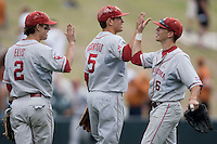 Cale Ellis #2, Caleb Bushyhead #5, and Erik Ross #6 of the Oklahoma Sooners celebrate their victory against the Texas Longhorns in NCAA Big XII baseball on May 1, 2011 at Disch Falk Field in Austin, Texas. (Photo by Andrew Woolley / Four Seam Images)