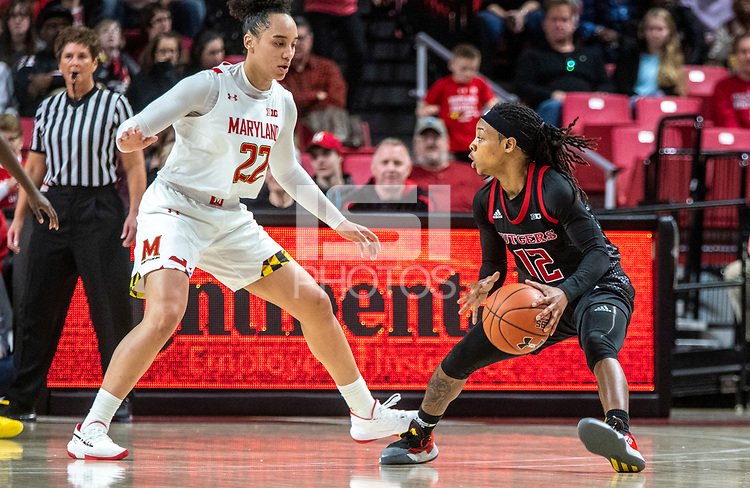 COLLEGE PARK, MD - FEBRUARY 9: Blair Watson #22 of Maryland blocks Khadaizha Sanders #12 of Rutgers during a game between Rutgers and Maryland at Xfinity Center on February 9, 2020 in College Park, Maryland.