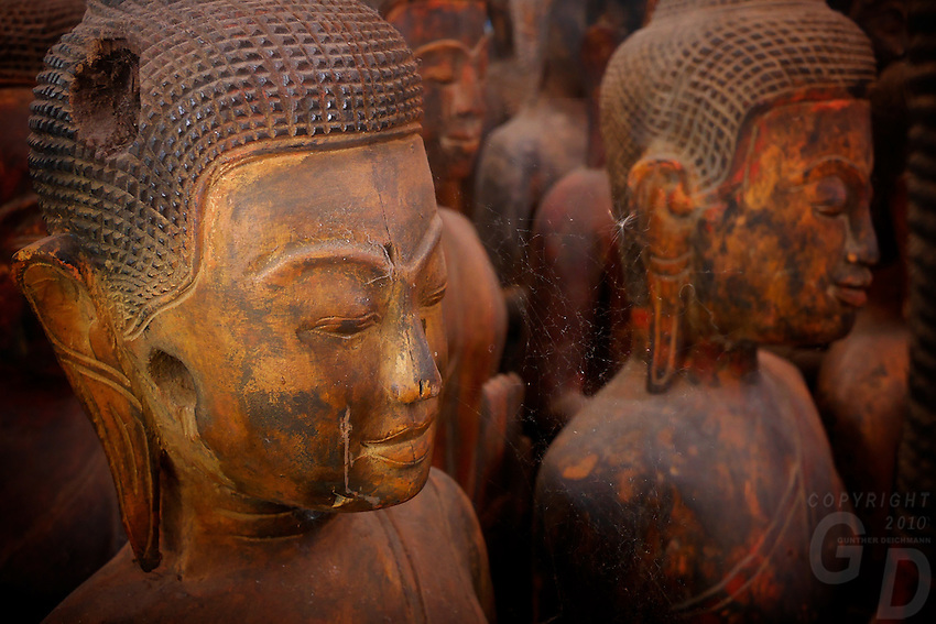 Fake wooden Antiques and Buddha carvings sold a shop in Phnom Penh near the Russian market