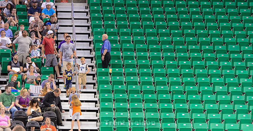 Trent Nelson  |  The Salt Lake Tribune<br /> usher blocking off section of seats during the 2015 NBA Draft party. Jazz fans were invited to EnergySolutions Arena in Salt Lake City, Thursday June 25, 2015 to watch a broadcast of the draft.