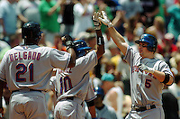 New York Mets David Wright, right, celebrates his RBI three run home run with teammates Carlos Delgado, left, and Endy Chavez, center, off Philadelphia Phillies starting pitcher Cory Lidle in the first inning MLB game Thursday, June, 15, 2006 in Philadelphia. NEWSDAY/Bradley C Bower)