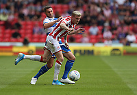Stoke City's James McClean and Queens Park Rangers' Angel Rangel <br /> <br /> Photographer Stephen White/CameraSport<br /> <br /> The EFL Sky Bet Championship - Stoke City v Queens Park Rangers - Saturday 3rd August 2019 - bet365 Stadium - Stoke-on-Trent<br /> <br /> World Copyright © 2019 CameraSport. All rights reserved. 43 Linden Ave. Countesthorpe. Leicester. England. LE8 5PG - Tel: +44 (0) 116 277 4147 - admin@camerasport.com - www.camerasport.com