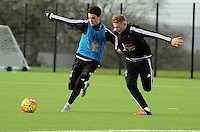 Pictured L-R: Owain Jones and Oliver McBurnie Wednesday 23 December 2015<br /> Re: Swansea City FC training ahead of their West Bromwich Albion game, Fairwood, near Swansea, Wales, UK