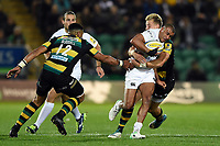 Jonathan Joseph of Bath Rugby takes on the Northampton Saints defence. Aviva Premiership match, between Northampton Saints and Bath Rugby on September 15, 2017 at Franklin's Gardens in Northampton, England. Photo by: Patrick Khachfe / Onside Images