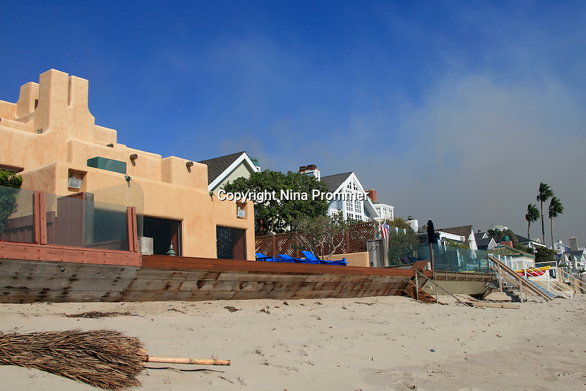 The beach front house of pop singer Sting was spared by the fire in Malibu, California October 21, 2007. Firefighters watch the brush below. The wildfire fanned by powerful winds burned out of control on Sunday in the celebrity seaside enclave of  Malibu, forcing hundreds of people to flee and destroying a handful of multimillion-dollar homes. Photo by Nina Prommer/Milestone Photo.