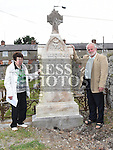 Clare McEvoy stands with Francie Gogarty at the grave of her uncle Jack McEvoy a bodyguard to Michael Collins. He died on 22nd October 1922. The headstone was recently restored and re-erected in the Cord Cemetery by Francie and his son David. Photo:Colin Bell/pressphotos.ie