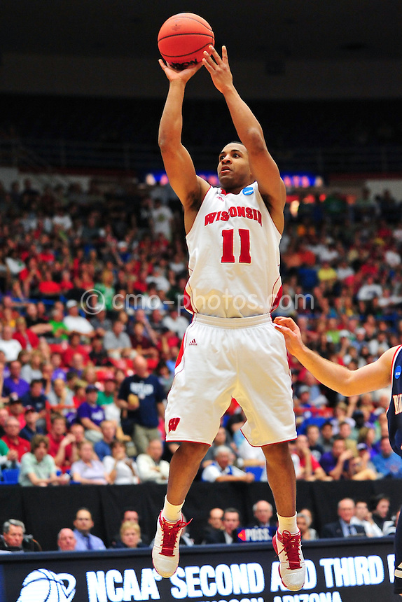 Mar 17, 2011; Tucson, AZ, USA; Wisconsin Badgers guard Jordan Taylor (11) shoots the ball in the second half of a game against the Belmont Bruins in the second round of the 2011 NCAA men's basketball tournament at the McKale Center.  The Badgers won 72-58.