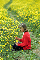 Young girl in dandelion field. Near Alpine, Oregon.