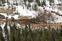 Aerial of Benoit Gerard crossing barren ground on the trail near Egypt mountain after leaving the Rohn Checkpoint during Iditarod 2008