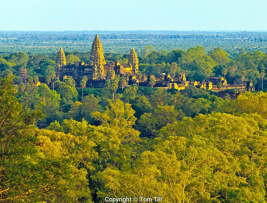 Angkor Watt   towers rise above jungle      Angkot Wat Archeological Park, Cambodia    Built 1113-1150 AD     Khymer culture ruins