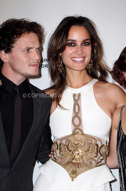 WWW.ACEPIXS.COM<br /> <br /> April 19 2014, New York City<br /> <br /> <br /> Anton Yelchin and Berenice Marlohe attends the '5 To 7' Cast Dinner At Supper Suite By STK Hosted With Fiji Water And Dobel Tequila on April 19, 2014 in New York City. <br /> <br /> <br /> By Line: Nancy Rivera/ACE Pictures<br /> <br /> <br /> ACE Pictures, Inc.<br /> tel: 646 769 0430<br /> Email: info@acepixs.com<br /> www.acepixs.com