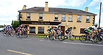 Riding through Crookedwood during the Irish National Men's Elite Road Race Championships held over an undulating course featuring 9 laps centered in the village of Multyfarnham, Co.Westmeath, Ireland. 29th June 2014.<br /> Picture: Eoin Clarke www.newsfile.ie