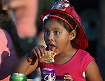 Mariela Bautista, 6, enjoys a hot dog during the 14th annual National Night Out in Carson City, Nev., on Tuesday, Aug. 2, 2016. <br />