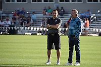Kansas City, MO - Saturday May 28, 2016: FC Kansas City head coach Vlatko Andonovski talks to team co-owner Chris Likens before the game against the Orlando Pride during a regular season National Women's Soccer League (NWSL) match at Swope Soccer Village. Kansas City won 2-0.