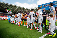 SWANSEA, WALES - APRIL 04: Players shake hands prior to the Premier League match between Swansea City and Hull City at Liberty Stadium on April 04, 2015 in Swansea, Wales.  (photo by Athena Pictures)