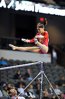 02/20/09 - Photo by John Cheng for USA Gymnastics.  Japanese Kyoko Oshima Moore performs on uneven bars in a meet against Japan before the Tyson American Cup at Sears Centre Arena in Chicago.