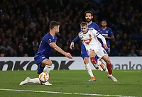 MOL Vidi's with a shot at goal under pressure from Chelsea's Gary Cahill<br /> <br /> Photographer Rob Newell/CameraSport<br /> <br /> UEFA Europa League - Group L - Chelsea v MOL Vidi - Thursday 4th October 2018 - Stamford Bridge - London<br />  <br /> World Copyright © 2018 CameraSport. All rights reserved. 43 Linden Ave. Countesthorpe. Leicester. England. LE8 5PG - Tel: +44 (0) 116 277 4147 - admin@camerasport.com - www.camerasport.com