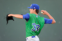 Starting pitcher Luke Farrell (33) of the Lexington Legends warms up before a game against the Greenville Drive on Thursday, April 24, 2014, at Fluor Field at the West End in Greenville, South Carolina. Greenville won, 9-4. (Tom Priddy/Four Seam Images)