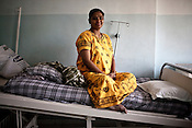 37 year old surrogate mother, Hamza Christian poses for a photograph at the Akanksha Infertility and IVF Clinic in Anand, Gujarat, India. The centre has become the most popular clinic for outsourcing pregnancies by western couples.