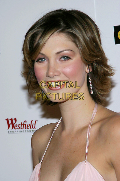 DELTA GOODREM.G'Day LA Penfolds Black Tie Gala at the Century Plaza Hotel, Century City, California..Photo credit: Jacqui Wong/AdMedia.January 13th, 2004.headshot, portrait, dangling earrings, halterneck.www.capitalpictures.com.sales@capitalpictures.com.© Capital Pictures.