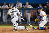 Logan Harvey (15) of the Wake Forest Demon Deacons follows through on a base hit against the Florida Gators in Game One of the Gainesville Super Regional of the 2017 College World Series at Alfred McKethan Stadium at Perry Field on June 10, 2017 in Gainesville, Florida.  The Gators defeated the Demon Deacons 2-1 in 11 innings.  (Brian Westerholt/Four Seam Images)