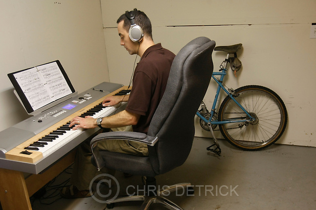 """President Todd Wilson practices 'Nocturne Opus 9 No. 2' by Frederic Chopin on the piano in the basement computer server room of the Screen-Scraper office in Provo, Utah Thursday October 7, 2010.  Screen-Scraper specializes in extracting data on the internet and has business since 2002..CREDIT: Chris Detrick for The Wall Street Journal.""""WTKSCRAPE"""""""